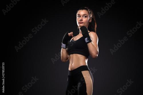 Fotografia, Obraz Sportsman, woman boxer fighting in gloves on black background