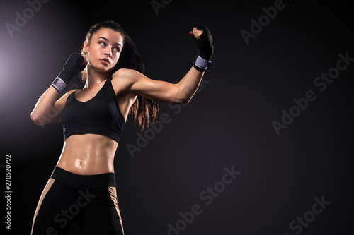 Fotografía  Sportsman, woman boxer fighting in gloves on black background