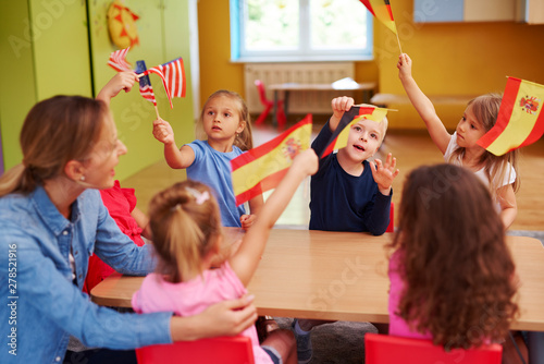 Group of  children learning languages during lessons in the school Fotobehang