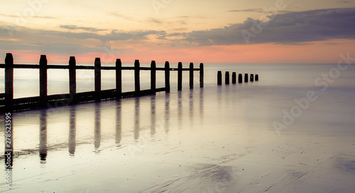 Fotobehang Crimson Groynes at beach