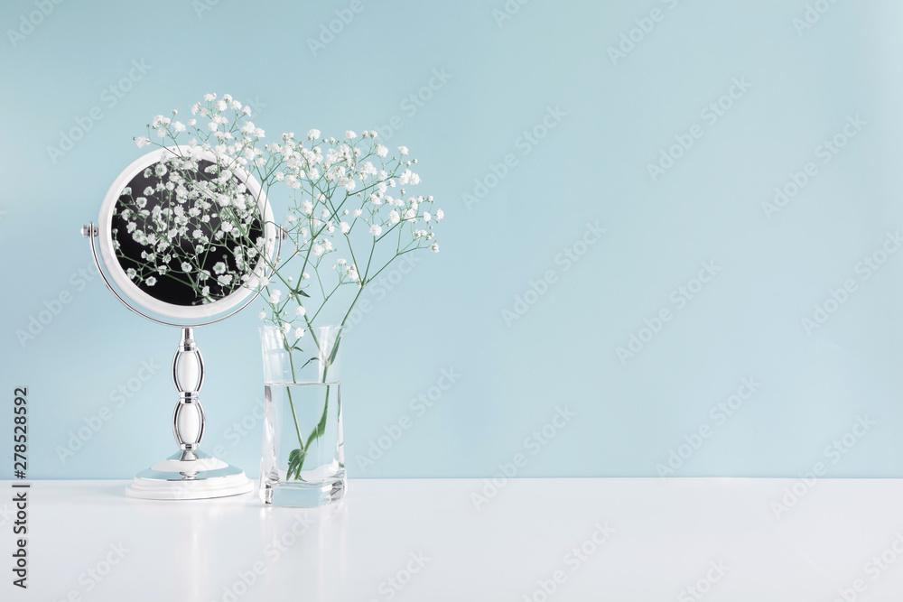 Fototapety, obrazy: Soft light bathroom decor in pastel blue color, mirror, white flowers, accessories on white wood shelf. Elegant decor bathroom interior.