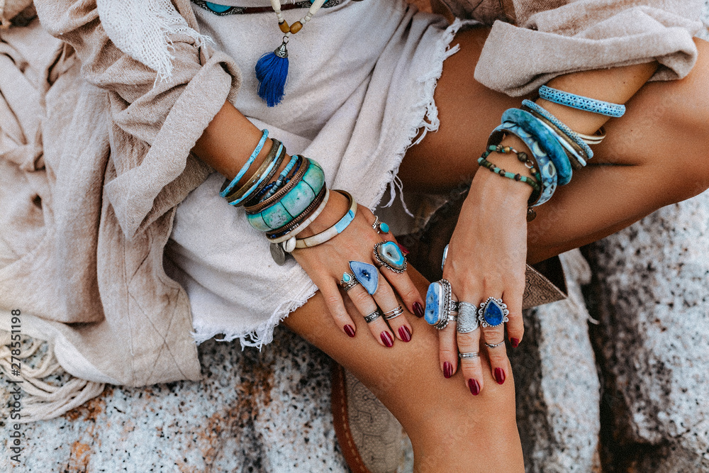 Fototapeta close up of young woman with lot of boho accessories outdoors