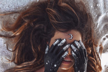Close Up Of Beautiful Young Woman Cover Eyes With Hands Painted Black. Night And Moon Concept