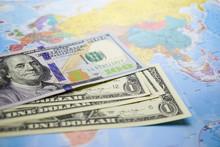 US Dollar Banknotes On Globe World Map.