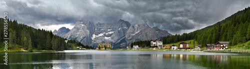 Obraz Beautiful Panorama at Misurina lake with Sorapiss Dolomitic Group on background and dramatic cloudy sky. Sexten Dolomites near Cortina d'Ampezzo, Italy. Europe. - fototapety do salonu