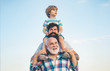 Leinwandbild Motiv Men generation: grandfather father and grandson are hugging looking at camera and smiling. Fathers day concept. Generation concept. Weekend family play. Men in different ages.