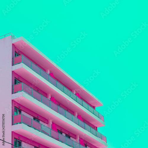 Foto Pink hotel and green sky in infrared style
