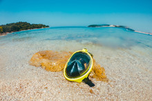 Yellow Snorkeling Mask At Sea Beach Close Up