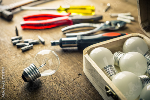 Photo  Implement Tools to Change Light Bulbs