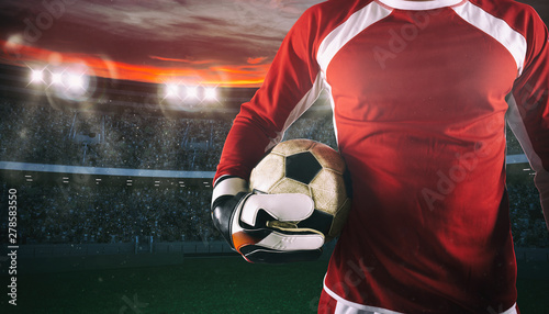 Fotografía Goalkeeper ready to play with ball in his hands at the stadium