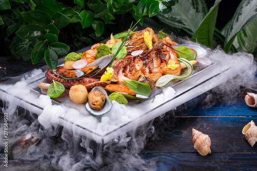 dish of seafood set on wood...