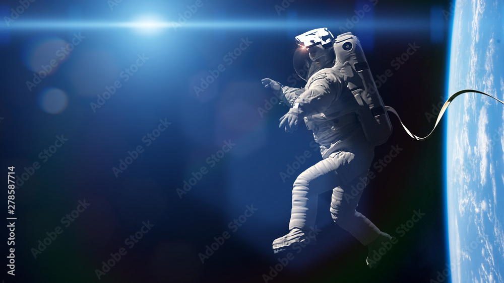 Fototapety, obrazy: astronaut performing a spacewalk in orbit of planet Earth
