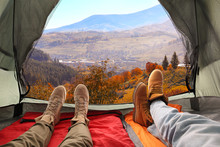 Closeup Of People In Camping Tent With Sleeping Bags On Mountain Hill, View From Inside