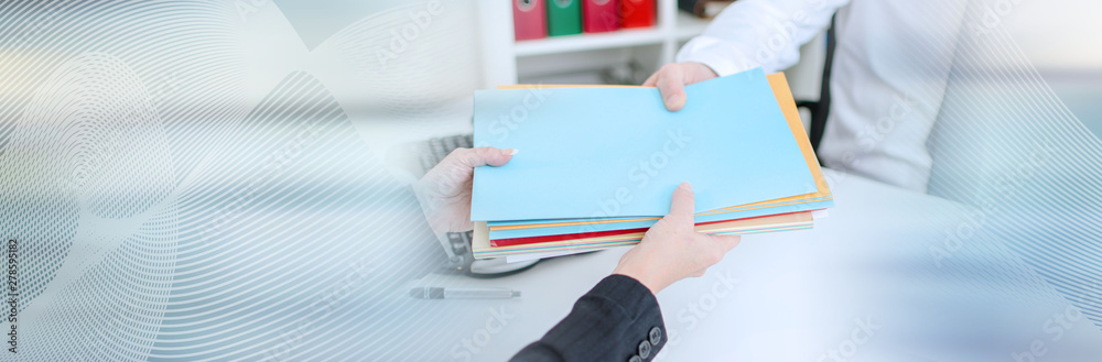 Fototapety, obrazy: Secretary putting files in the hand of a businessman; panoramic banner