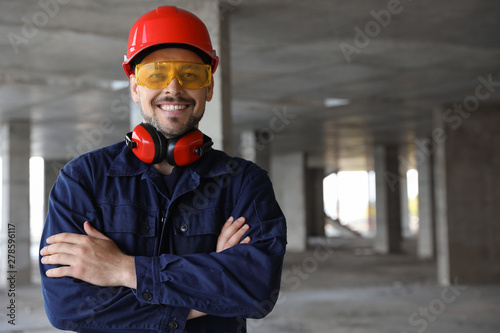 Valokuva  Professional engineer in safety equipment at construction site, space for text