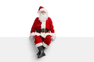 Santa claus sitting on a white banner