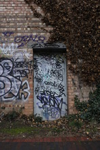 Door Covered In Graffiti