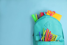 Stylish Backpack With Different School Stationary On Light Blue Background, Top View. Space For Text