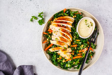 Grilled Chicken Breast Salad With Kale, Pine Nuts And Caesar Dressing In A White Plate.