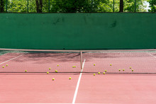Hard Tennis Court Outdoor, Tennis Net And Yellow Balls Near, Green Concrete Wall Background