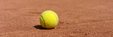 Yellow Tennis Ball On Clay Cou...
