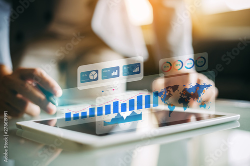 mata magnetyczna Businessman investment consultant analyzing company financial report balance statement working with digital augmented reality graphics. Concept for business, economy and marketing. 3D illustration.