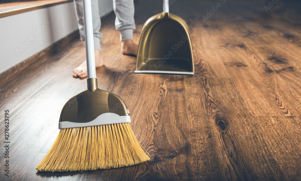 Fototapeta woman hand broom dustpan on the ground