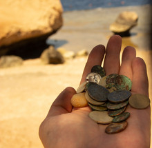 The Photo Of Gold And Silver  Coins Collected With Help Of Underwater Metal Detector. Treasure Searching And Tourist Adventure Background.