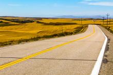 Idaho Highway Thru Wheat And Grain Farms Near Grand Teton National Park In Eastern Idaho