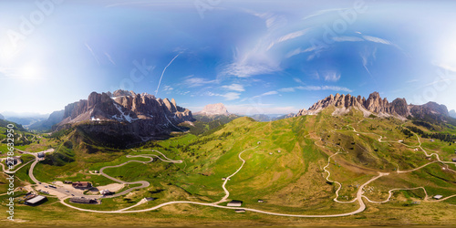 Obraz Aerial top 360 degree view to wonderful alpine landscape and meadows at Pass Gardena with majestic Sella mountain group in Dolomiti. Alps, South Tirol, Dolomites mountains, passo di Val Gardena, Italy - fototapety do salonu