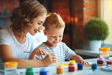 Mother And Child Son  Painting Draws In Creativity In Kindergarten
