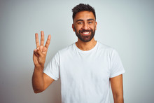 Young Indian Man Wearing T-shirt Standing Over Isolated White Background Showing And Pointing Up With Fingers Number Three While Smiling Confident And Happy.