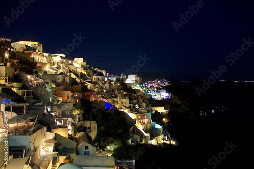 Poster Pleine lune Night scene of Santorini Island, Greece. Santorini is the most popular island for a good reason, fantastic beaches and nightlife.