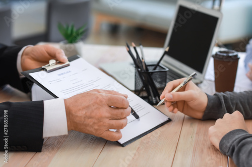 Obraz Man signing documents at notary public office - fototapety do salonu