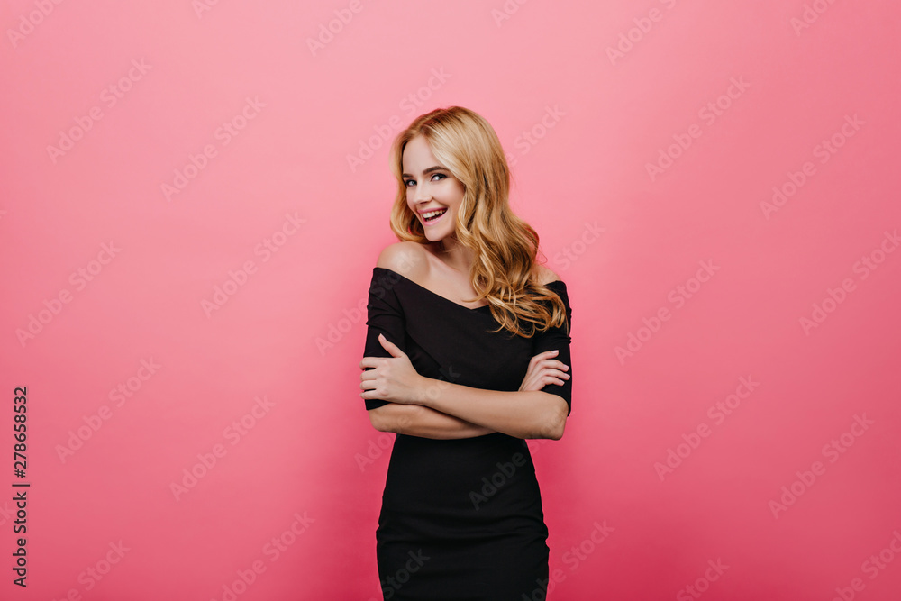 Fototapety, obrazy: Wonderful shapely girl in long dress posing with arms crossed. Ecstatic caucasian female model with trendy hairstyle standing on pink background with smile.