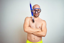 Young Man Wearing Diving Snorkel Goggles Equipent Over Isolated Background Happy Face Smiling With Crossed Arms Looking At The Camera. Positive Person.