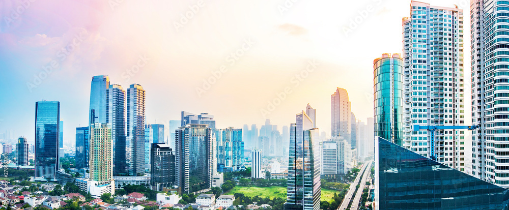 Fototapeta Panoramic Jakarta skyline with urban skyscrapers in the afternoon