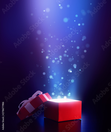 Photo  Red open gift box with magical light