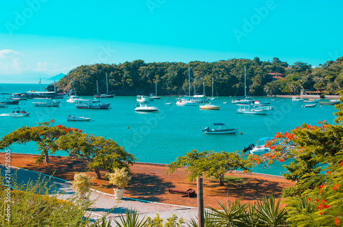 Fotobehang Turkoois Buzios, Brazil - february 24, 2018: Streets of Buzios are filled with shops and restaurants are popular for tourists to visit at night time.
