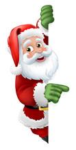 Santa Christmas Cartoon Character Peeking Around A Sign And Pointing At It