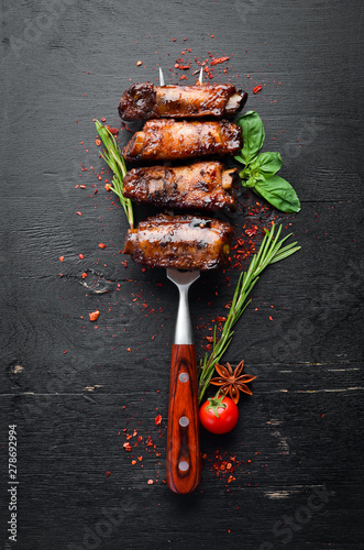Fototapeta Pork ribs on the fork