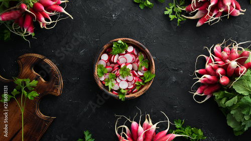 Obraz na plátně  Sliced radishes on a Wooden Table