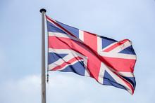 Great Britain Flag Waving Against Clear Blue Sky
