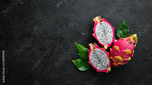 Fresh Pytahya on a black background. Dragon Fruit. Tropical Fruits. Top view. Free space for text. - 278693990