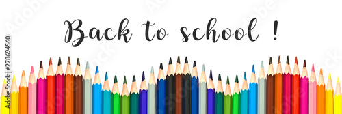 "Panorama of colorful pencils on white background with text ""back to school"""