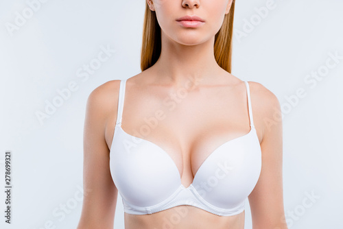 Healthy lifestyle concept. Cropped close-up portrait of nice calm lovely attractive adorable blonde girl chest wearing bra isolated over light gray background