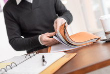 Businessman Looking For Document In Folder