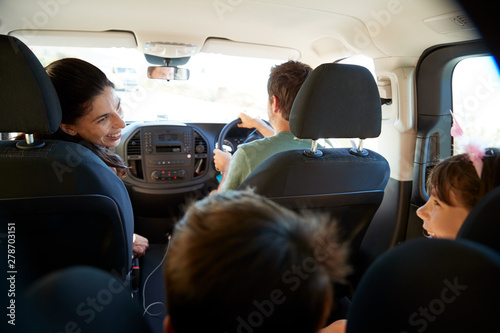 Young white family making a trip in their car, close up, back view car interior shot - 278703151