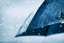 Blue Umbrella Under Heavy Rain...