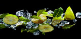 Mint, lime slices and ice on the glass table, bottom view.